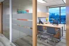 Executive Offices - Vancouver - Designs on the  glass add some privacy to glass walled offices.