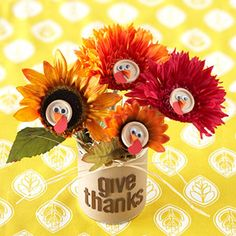 Turkey Bouquet....made with artificial flowers, buttons, googly eyes and colored paper.  Fun!