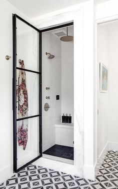 Black and white floor mosaic tile + modern black and white bathroom + black steel and glass shower door + marble surround around the shower + black tile on the shower floor Modern Shower, Modern Bathroom, Small Bathroom, Bathroom Black, Bathroom Ideas, Small Shower Room, White Bathrooms, Bathroom Showers, Boho Bathroom