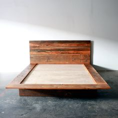 "Our handcrafted platform bed frame is made from reclaimed barn wood. Designed with a bordering platform on three sides to keep your books and other night time necessities within reach. Constructed in 5 separate pieces for convenient transport and easier maneuverability through the home. Basic assembly requires a screwdriver and wrench. Step-by-step instructions included. DETAILS • Queen 74""w x 90""l • King 90""w x 90""l • CA King 86""w x 94""l • Headboard height 40 • Platform height 9 •…"