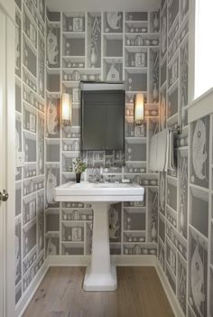 A fun WC with whimsical wallpaper. Design by Arciform designer Kristyn Bester.