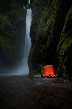 Camping by the waterfall. Wilderness Campsites and Backpacking.
