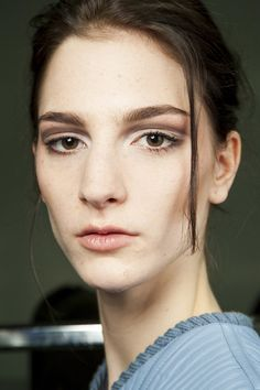 Spring 2015 beauty - At Giorgio Armani, Linda Cantello created a softly sculpted look, with contoured cheeks, nude lips and eyes defined in neutral-toned shadows with a Sixties-style sweep of metallic brown in the crease of the lids.