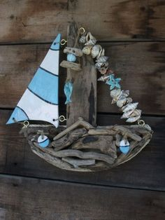 I really love my driftwood/ceramic boat by Karen Watson (similar to this but yellow) Sea Crafts, Seashell Crafts, Nature Crafts, Driftwood Projects, Driftwood Art, Beach Wood, Beach Art, Beach Signs, Shell Art