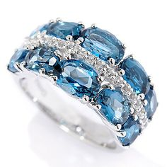 Decorate a digit with a splash of bright color! Here's your new go-to ring. Topaz Jewelry, London Blue Topaz, White Topaz, Band Rings, Cuff Bracelets, Blue And White, Wedding Rings, Engagement Rings, Gemstones