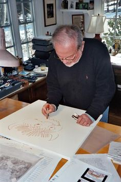 Children's book writer and illustrator, Maurice Sendak, working in his art studio.