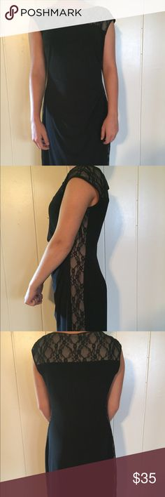 Black cocktail dress Sleeveless form fitting with sections of floral lace. Chaps Dresses