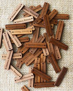 Custom Sew On Labels   Wooden Tags   Wooden Labels   Clothing Tags   Labels for Handmade Made from 3mm thick walnut wood and engraved with your custom text these wooden sew on labels add a charming finishing touch and the artisan feel to your handmade product. Our wooden labels can be sewn on to hats, jumpers, gloves and many other items or attached to the packaging. Features Dimensions: 4cm x 1cm Hole diameter: 2mm Material: oak wood Should you require a different shape or size please re...