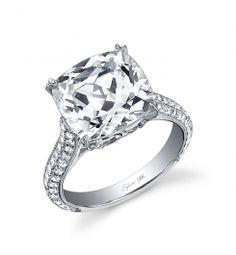 Style #SY461  1 Carat Diamond Engagement Ring    This dazzling 18k white gold diamond engagement ring features a 1 carat cushion cut diamond. Round brilliant diamonds surround the center stone and flow down the sides of this ring for a total carat weight of 1.12 carats.