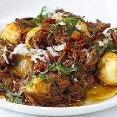 Soft little ricotta dumplings with meat sauce.