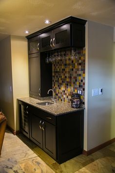 Small bar area with mosaic tile on back splash