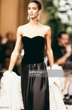 A model walks the runway at the Yves Saint Laurent Haute Couture Fall/Winter 1989-1990 fashion show during the Paris Fashion Week in July, 1989 in Paris, France.