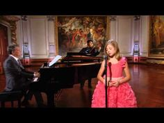 Jackie Evancho singing 'Dark Waltz'. Absolutely incredible, haunting, gorgeous voice. Reminiscent of Loreena McKennitt. The voice of an adult in the body of a 12-year-old girl. Amazing...