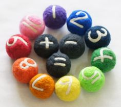 Maths counting balls - needle felted wool. Easy to make, possibly with children. Use a big marble in the ball to save on wool and to give it some weight, making it easier to throw.