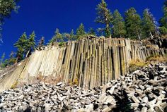 Outdoor travelers may desire to witness an unusual landmark besides a national park with sweeping views. The Devils Postpile is a rare geological site that ranks as one of the world's finest examples of columnar basalt. Located near Mammoth Mountain in California, the site's columns tower over 60 feet high, displaying unusual symmetry.