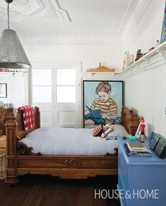 huge light fixture, antique toys displayed on a plate rail around room Charming Little Boy's Room | House & Home