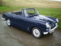 1960 Triumph Herald...one of the little cars my Dad brought home. Great car for Saturday night runs to Baskin Robbins.