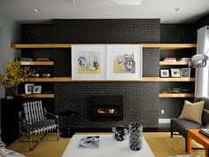 Tips on hiding the tv! Love the sliding paintings! >Living room. Ask about price.