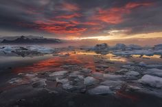 the icy serenity of Jokulsarlon. capture some great shots of ice crystals washed up and scattered across the black sand beaches. start early with a sunrise shoot from the beach, and aim to capture the sun's first rays illuminating the lagoon.