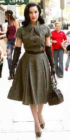 Dita von Teese, long leather gloves and 50s woollen dress.