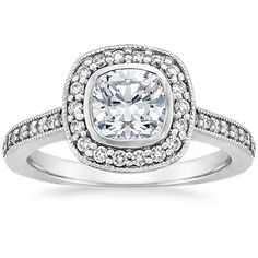 18K White Gold Fancy Bezel Halo Diamond Ring with Side Stones (1/3 ct. tw.) from Brilliant Earth
