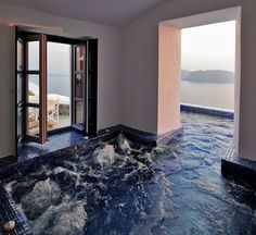 This indoor/outdoor hot tub is located in a hotel in Greece but I would LOOOOVE to have this in my future home.