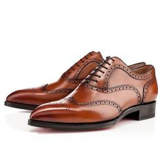 """New Platers"" in cognac is the classic brogue oxford that will become a staple in your red soled collection. His handsome, pointed toe puts a contemporary twist on this traditional style, and is the perfect match for your tailored looks."