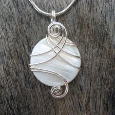 White Mop Shell Silver Wire Wrapped Pendant Necklace by CareMoreCreations.com, $25.00