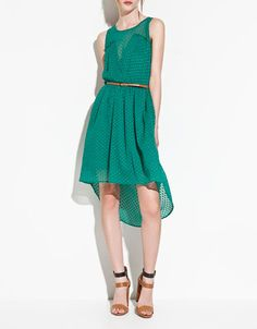This deep V on the front, plus the asymmetrical skirt make this dress bold but the color is delicious. Also comes in creme.