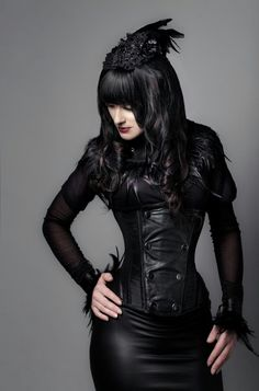Gorgeous gothic girl in leather and feathers