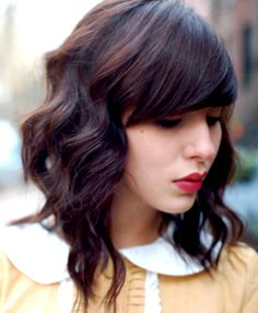 chocolatey warm toned brunette. soft waves, heavy bang.