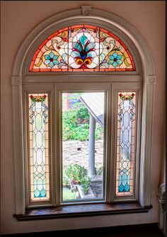 A beautiful vintage stained glass window on a stair landing