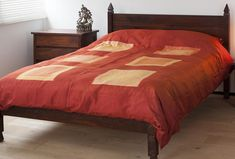 A red silk duvet cover set in shades of warm red and mid burnt orange. Made in India exclusively for Natural Bed Company. Buy Online. Free UK Delivery.
