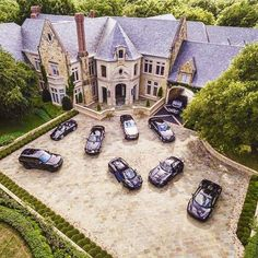 Mega mansion with the following cars parked in front : Mercedes G63 AMG, Rolls-Royce Phantom Coupe, Mercedes S65 AMG Coupe, Porsche 911, Bentley Mulsanne, Mercedes SLS AMG Black Series, Range Rover, Ferrari 458 Italia, & a McLaren MP-4 12C Spyder. (I know my cars )