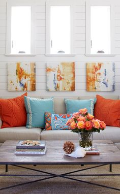 that's actually a really great idea. Putting abstract painting behind your furniture to pull together bold clolors. Me GUSTA!!!