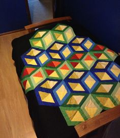 Optical illusion quilt - reminds me of the old Q*Bert game! Pattern by Karen Combs