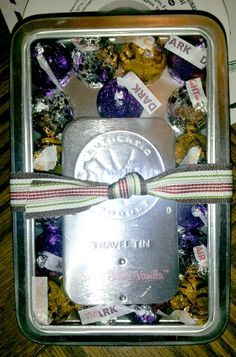 I gussied up the Scentsy travel tins that I got for The Man's admins at work...had the window tins from a previous project, added caramel kisses, dark chocolate, and air kisses, tossed a striped Christmas ribbon around it!