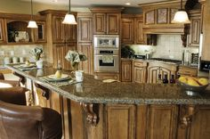 Rustic Country Kitchens | Kitchen Renovation with island, marble countertops and custom cabinets