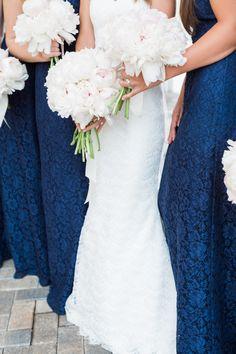 Classic navy blue lace bridesmaid gowns: http://www.stylemepretty.com/florida-weddings/naples-fl/2015/08/19/romantic-yacht-club-wedding/ | Photography: Hunter Ryan Photo - http://hunterryanphoto.com/