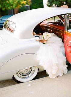white car and wedding dress. Making memories