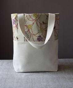 Cute tote bag.  Mine included fabric appliqued hand prints from my kids.