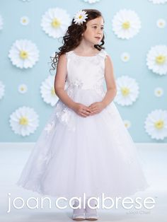 mon cheri bridals 116377 - Sleeveless satin, tulle and lace tea-length A-line dress, lace and three-dimensional flowers adorn bateau neckline and natural waist, satin bodice, back covered buttons, full gathered tulle skirt with lace and flowers and wire edge.