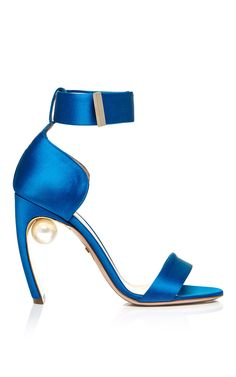 This sandal by Nicholas Kirkwood is rendered in peacock blue satin and features a pearl fixed between the heel and the body. Preorder now on Moda Operandi