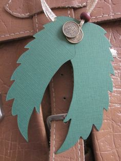 Angel wings made of green texture cardstock adorned with coins --- Perfect as Christmas ornament, original gift or hang them on the wall. €5,95, via Etsy.