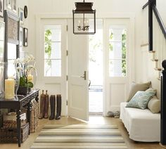 I love this entry hall... boots add a bit of 'country'