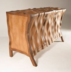 Beautiful hand crafted furniture by Edward Johnson - each piece marked by a thumbprint cast in silver