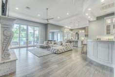 """""""View this Great Contemporary Living Room with stone fireplace & French doors in Paradise Valley, AZ. The home was built in 2008 and is 8023 square feet. Discover & browse thousands of other home design ideas on Zillow Digs."""""""