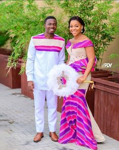 So we've rounded up some gorgeous kente styles for couples. If you are getting married and you want a kente style that will work for you and your partner, African Dresses For Kids, African Inspired Fashion, Latest African Fashion Dresses, African Dresses For Women, Africa Fashion, African Traditional Wedding Dress, Traditional African Clothing, Couples African Outfits, African Wedding Attire