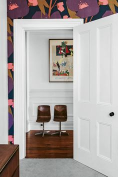Vintage French wallpaper frames the door to this hallway where a print from the homeowner's parents sits above two children's chairs bought from a second-hand dealer. Decor Interior Design, Interior Decorating, French Wallpaper, Buy Chair, Built In Bench, Dining Nook, Interior Photography, Open Plan Kitchen, Elegant Homes