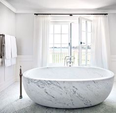 At Villa Maria, a historic manor in Water Mill, New York, the master bath's custom-made marble tub features Waterworks fittings; the space was decorated by CarolEgan Interiors. Bad Inspiration, Decoration Inspiration, Bathroom Inspiration, Bathroom Ideas, Bathtub Ideas, Bathroom Inspo, Dream Bathrooms, Beautiful Bathrooms, Luxury Bathrooms